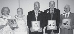 Receiving honors at the annual Fulton County Agriculture Hall of Fame banquet were, from left: Jeanne Purkey Howison, Galion, and Marilyn Purkey Neason, Athens, accepting on behalf of their late father, D. R. Purkey, former Wauseon High School vo-ag teacher; Roger Snyder, rural Delta; Dick Tedrow, Denton, Texas; and Cliff Shelt, Delta.- photo by David Pugh
