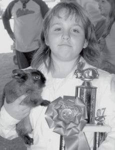 Hannah Roth, Pettisville, with her grand champion rabbit