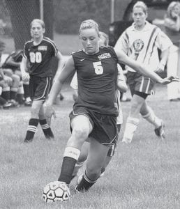 Nicole Babcock dribbles the ball up the field in Blue Streak soccer action against Springfield, Tuesday, Aug. 21. Archbold is 3-0-1 after two weeks of play.- photo by Scott Schultz