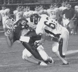 Jimmy Dunning, left, gets pulled down by a pair of Golden Bears. The AHS senior caught a record-setting 93-yard touchdown pass to also enter the Blue Streak record books.- photo by Scott Schultz