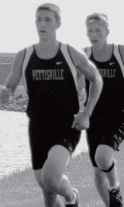 Alex Frey, left, led the Blackbirds to victory in the boys race against Archbold and Evergreen. Austin Borton, right, was second. Pettisville captured five of the top eight places in the race to win the tri-meet.- photo by D.J. Neuenschwander