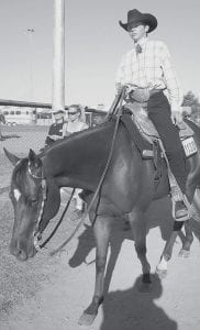 Jake Gigax, Archbold, rides tall in the saddle aboard his horse,