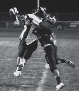 An Apache is called for pass interference as Archbold's Ian Redd, right, goes up for the ball.- photo by Scott Schultz