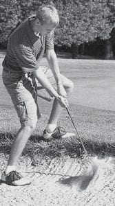 Micah Grime chips out of a sand trap. He shot a 41 in Archbold's tri-meet victory over Ottoville and Ayersville last week.- photo by  David Pugh
