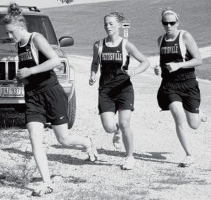 Hannah Beck, Rachel Beck, and Jackie Morrill, from left, ran for Pettisville at the Archbold Cross Country Invitational, Saturday, Sept. 8.- photo by D.J. Neuenschwander