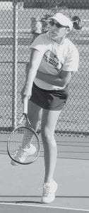 Emily Fredrick serves in AHS tennis action. The Streaks dropped to 0-7 last week.- photo by Scott     Schultz
