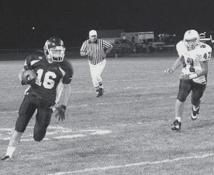 Blue Streak Nate Hammersmith (16) turns the corner for valuable yardage against Swanton. Archbold rushed 114 yards and passed 331 in the 60-14 NWOAL victory over the Bulldogs, Friday, Sept. 21.- photo by Scott Schultz
