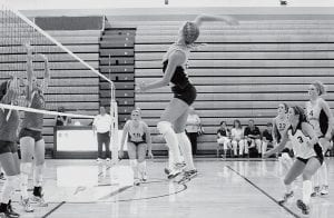 Dani Newman is ready for a kill in Archbold's contest with Patrick Henry, Tuesday, Sept. 11. The Streaks finished third at the Golden Spike Invitational, Saturday, Sept. 22, and host the Streak Spike-Tacular this Saturday, Sept. 29.- photo by  Scott Schultz