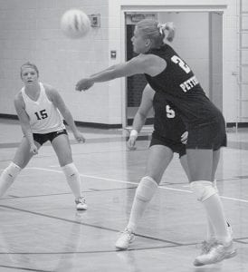 Jodi Spotts (2) receives serve for the Blackbirds in their BBC win over North Central, Tuesday, Sept. 18. Libero Kirstin Yoder (15) is ready to assist.- photo by Mary Huber