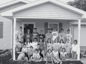 Members of the Groundbreakers, a multi-denominational youth group sponsored by Archbold United Methodist Church, include, front row from left: Stephan Manahan, Jase Grosjean, Evan Wyse, Jay Miller, Gavin Morton, Lexi Giesige, Paige Merillat, Myah Wagner. Middle row: Bryce Tinsman, Nick Cassidy, Caroline Vonier, Taylor Price, Chandler Stevens, Abby Austin, Abby Claire Miller, Hanna Allison, Krista Leupp, Desi Newman, Erin Erbskorn. Back row: Chandler Tinsman, Aaron Wyse, Clay Giesige, Justin Allison, Sarah Wyse, Garrett Morton, Travis Roehrig, Matthew McCoy. Sixty-three boys and girls built a new home for their friend, Chandler Stevens, and his mother, Mary Austen.- photo courtesy Lisa Allison