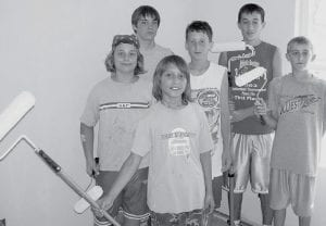 Above, the 62 kids who helped build a new home for Chandler Stevens and his mom had a huge to-do list.