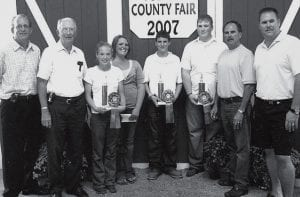Showmanship scholarship winners and sponsors, from left: Mike Kreuz and Al Kreuz, Smith's Family Restaurant; Kira Andre; Mckenzie Banister; Justin Pursel; Dylan Weirauch; Ray Childs, Childs Investment Group.