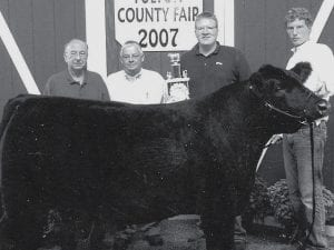 Reserve champion steer winner Joshua Bruner, Wauseon, right, son of Mark and Jane Bruner. Purchasers, from left: Daryl Nofziger, Archbold Equipment; Dean Nofziger, Dean and Greg Nofziger Seeds; A.J. Genter, Sky Bank.