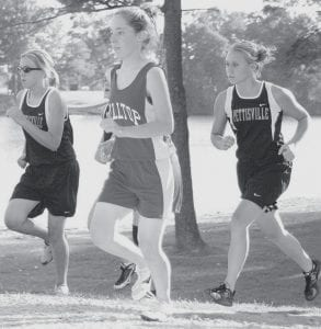 Runners, Jackie Morrill, left, and Morgan Lantz, right, keep pace in Pettisville cross country. Both were named Third Team All-BBC.-      photo by D.J. Neuenschwander