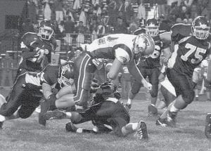 This fourth-quarter hit on Patrick Henry's Gary Cole caused a fumble that was recovered by the Blue Streaks at the PH 40-yard line. Eight plays later, Gene Goering passed to Jimmy Dunning for a 16-yard touchdown pass.- photo by Jaycee Riley