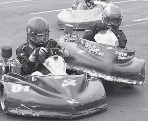 Josh Wyse, Archbold, right, tangles with another racer during stock light class action at Sunday's kart racing in Archbold. This scene was repeated several times by many drivers as they fought for positions.-      photo by David Pugh