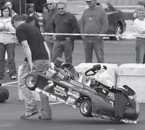 Josh Wyse, Archbold, appears dejected as he drags his kart off the track. It broke down during stock light class action. Unlike bigger racers, which requires a tow truck, two adults can lift a race kart.- photo     by David Pugh