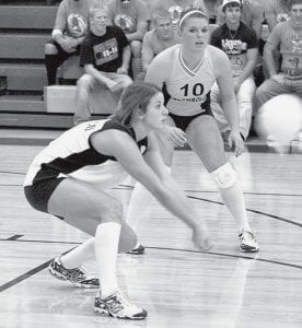 Laura Wyse, Archbold's libero, receives serve in Archbold's sectional championship over Liberty Center. Stacy Wyse (10), Blue Streak setter, watches the pass.- photo by Jaycee Riley