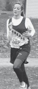 Katrina Gobrogge runs at the Div. III regional meet at Tiffin. She was Archbold's only runner.- photo by  Mike Nafziger