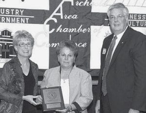 David and Siebenmorgen with Cindy Winzeler of TJ Automation. The firm was recognized for 10 years of service in the Archbold area.- photo courtesy        Royal Images