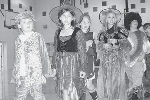 Archbold Elementary School youngsters wore Halloween costumes to school Wednesday, Oct. 31, and paraded for parents. From left are Cami Johns, first grade; Tori Manz, Neila Kinsman, Mackenzie Meyer, and Oran Humbert, fourth grade. - photo by David Pugh