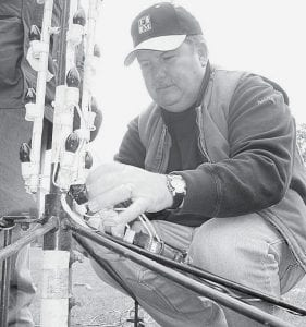 Ed Leininger, Archbold, makes electrical connections during Festival of Lights set-up day, Saturday, Nov. 10. The Festival opens Friday, Nov. 23 after the Parade of Lights.- photo by David Pugh