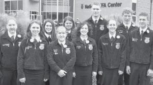 While in Indianapolis attending the National FFA Convention, Pettisville members visited the National FFA Center and the new National FFA Merchandising Center to view the history and operations of the FFA. Ffront row from left: Rachel Bernath, Rebekah Meller, Rachel Fry, Kris Michael, Tim Spiess. Back: Vicki Nofziger, Lynae Fry, Krista Spiess, Jerid Stine, Josh Bruner.- courtesy photo