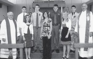 Trinity Lutheran Church, Wauseon, recently confirmed a class of seven. The students completed a three-year program of classroom instruction, field trips, and summer camps. Front row, from left: Roger Marlow, pastor; Natalie Miller; Kelsey Krieger; Shannon Sprow; Timothy Sonnenberg, pastor. Back row: Landon Schaffner, Adam Gerken, Frederick Pope, and Kaleb Burkholder.- courtesy photo