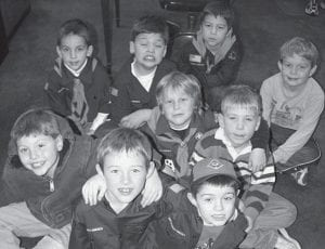 Archbold Cub Scouts visited the Archbold Buckeye to learn about publishing newspapers. They are, front row, from left: Simon Short, Gibson Burkholder, Elias Rash. Second row: Daniel Baus, Caden Garrow. Third row: Alex Scott, Jake Steusoloff, John Ruscigno, and Jeremiah Hartman.- photo by David Pugh