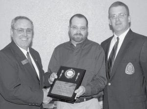 Representing the Pettisville FFA Alumni, Gene Meller, Jr., president, center, receives the Outstanding Agricultural Promotional Award from Sam Atherton, National FFA Alumni President-elect, left, and John Juhasz, Ohio FFA Alumni President.- courtesy photo