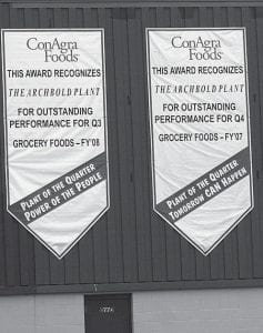 The Archbold ConAgra plant displays two banners, the most recent given to the plant for earning the title,