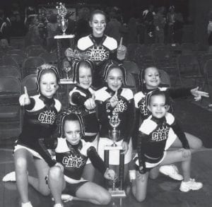 Archbold girls compete on the Class Act All-Stars competitive cheer team. Front row, from left: Sydney Rupp and Molly Conway, 8; second row: Allie McQuade, 10, Hanna Blankenship, 12, Malinda Lugbill, 9, and Hannah Gerig, 11. Standing is Rachel Brader, 12.- courtesy        photo