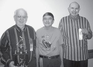Dale Gautsche, left, is the March shuffleboard winner at Fairlawn Haven Retirement Community, Archbold. Russ McQuillin, center, second; third was Fred Wells, right, third.- courtesy photo