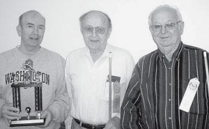 Hank Schwienhagen, left, was the winner of the March 3 pool tournament at Fairlawn Haven Retirement Community, Archbold. Wendell Newcomb, center, second, and Dale Gautsche, right, third. Newcomb had two runs of three balls in one game, while Gautsche had a run of five balls in the semifinals. - courtesy photo