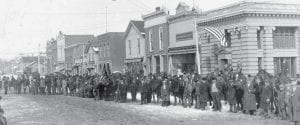 Old Photo Corner: Archbold merchants sponsored a winter horse show on a muddy main street of Archbold before the fire of August 1913. All the buildings in the photograph between the F&M State Bank, right, to the last building on West Holland Street, left, were destroyed. - antique photograph    from the collection of Evelyn Clair, formerly        of Ridgeville Corners