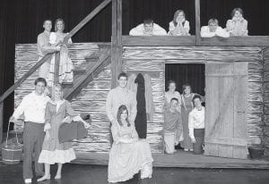 Opening night for the Archbold High School production of the musical Seven Brides for Seven     Brothers is Friday, April 11. Cast members are, stage level, from left: Christian Beck and Emily Grisier, playing Daniel and Liza; Garrett Leininger and Audrey Boyers, Adam and Milly; Seth Nofziger and Grace Yoder, Gideon and Alice; Cameron Bible and Nicole Rufenacht, Frank and Sarah. On the stairway are Dustin Kauzlick and Bekah Ruffer, Caleb and Ruth. Upper level of the set are, from left: Steve Bostelman and Jessanna Buschur, Ephrain and Martha; Micah Grime and Erin Cartwright, Benjamin and Dorcas .- photo by Rita Bilen