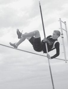 Lincoln Frey reaches for the clouds as he clears the bar in the pole vault. Frey won the event in Pettisville's tri-meet with Liberty Center and Emanuel Baptist.- photo by D.J. Neuenschwander