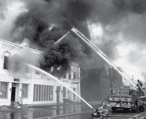 Fayette firefighters were among more than 20 Northwest Ohio departments called to Wauseon, Saturday morning, April 14, 2007, to battle a downtown fire. It destroyed half a block of downtown Wauseon. Fayette firefighters took up a position on West Elm Street, using a deluge gun and snorkel truck to fight the flames.- photo by David Pugh