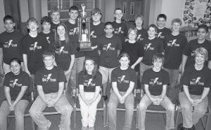 Members of the Archbold Middle School quiz team with the trophy they captured for winning the county tournament. It was the team's second straight county championship. Their season record was 7-2. Front row, from left, Emma Villanueva, Pete Schoenhals, Shayla Hayes, Dinah Rice, McCaylen Croninger, and Jan Lindsay, coach, Second row, from left, Adrian Ramirez, Jared Dominique, Ella Weaver, Kevin Baez, Tyler Bryan, Jeff Litogot, Nick Cassidy, and Christian Baez. Back row, from left: Kevin Fredrick, Adam Steider, Chan Tinsman, tournament MVP, John Hartman, team captain, Mason Gericke, Alec Zaborniak, and Zach Zimmerman.-    photo by David Pugh