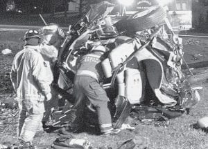 Archbold rescue workers freed Ramona Steffel, 57, Bryan, from the wreckage of her minivan after a collision at the intersection of St. Rt. 2 and Co. Rd. 22, Saturday night, April 12. Rescue workers had to bring her out through what was left of the rear of the vehicle.- photo     by David Pugh