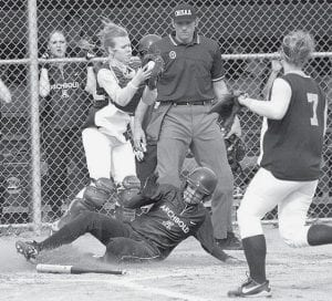 Adi Lange slides safely into home, giving Archbold a 3-0 lead against Edgerton. The Blue Streaks scored eight more runs for an 11-0 victory.-  photo by Scott Schultz