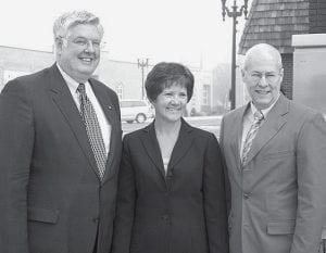 Mari Yoder, center, executive director of the Archbold Area Chamber of Commerce, will leave the post to become vice president of institutional development at Northwest State Community College. Paul Siebenmorgen, left, AACC president; Thomas Stuckey, right, NSCC president.- photo by David Pugh