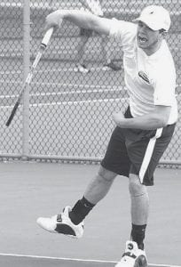 Ian Redd hits a forehand in one of Archbold's matches last week.- photo by Scott Schultz