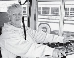 Karen Vonier at the controls of an Archbold Area School District bus. After more than 30 years in the driver seat, she decided to retire. She said she will miss her young passengers.- photo by Rita Bilen