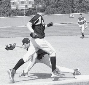 Pettisville's Josh Bruner is thrown out at first base on a pass from Archbold's Kyle Walker to David Rupp in their April 18 contest.- photo     by Scott Schultz