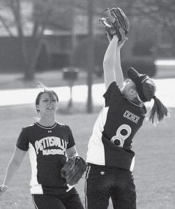 Blackbirds in the infield: Karina Rohrer-Meck watches Ashley Eicher catch a fly ball for Pettisville. The Birds are 5-7 on the season.- photo     by Scott Schultz