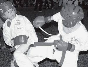 C.J. Brubaker, (left) sparring at a karate tournament in Cancun, Mexico. He brought home a gold medal. Brubaker recently completed testing for a black belt in the Shoalin Kenpo and San Ruy Do systems.- courtesy photo