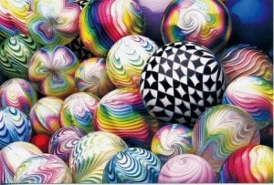 Mark Matthews creates amazing colorful spheres out of glass. When working with spheres,