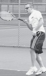 Peter Lehman hits a forehand in recent singles tennis action. The Streaks are 2-11 on the season.-  photo by Scott Schultz