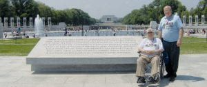 Several area World War II veterans traveled to Washington, D.C. as part of an Honor Flight to view the World War II Memorial. Olen Genter, top, seated, a veteran of the U.S. Army Air Corps, and his son, Dean, of Pettisville, are shown at the memorial. Dean was his father's guardian during the trip. Behind them is a fountain; tall structures on the sides are monuments to individual states. Olen, lower left, with a quote from Harry S. Truman carved in the memorial. Lower right: Charles